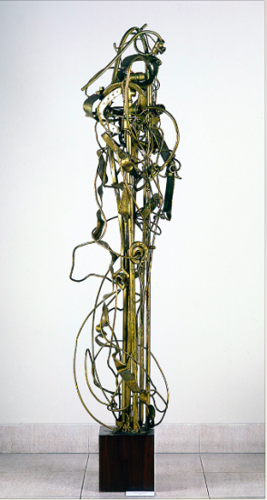 Juan Del Prete. Figura lunar, 1962. Assembled of painted woods and gold dust. 190 x 47 x 35 cm.